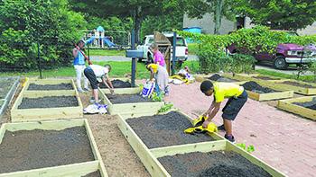 Farm Credit staff rebuild BGCCC garden