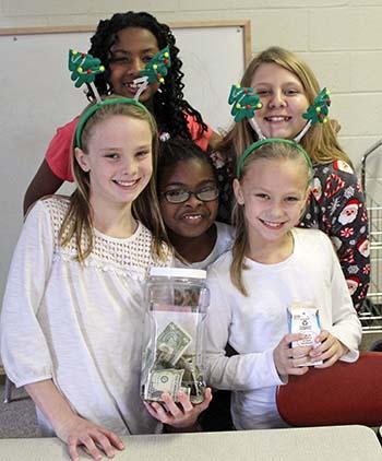 Girls on the Run Club raises money for homeless children at Christmas
