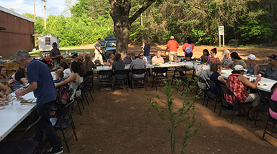 Gathering for an Earth Day potluck at Holly Oak Park community garden