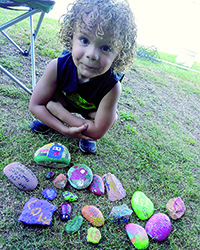 Hiding, hunting painted rocks new pastime