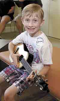 Young musicians pick and grin at Earl Scruggs Center