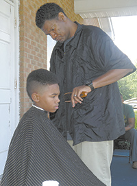 Keith Rhodes gives back-to-school haircuts...