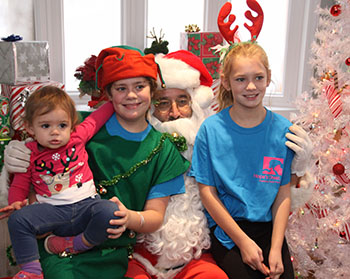 Paws and Claus fundraiser benefits Hope's Chest