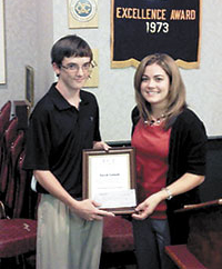 Cooper Receives Exchange Club A.C.E. Award
