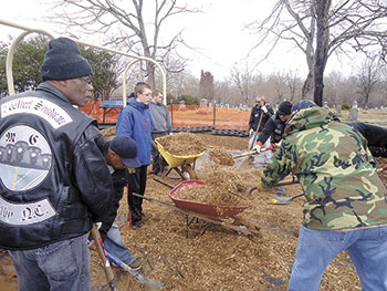 VOLUNTEERS BUILD PLAYGROUND...
