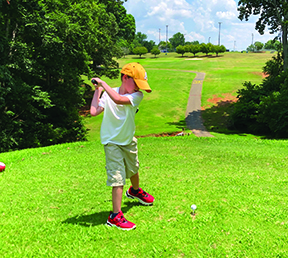 Henry Jernigan rares back to take a swing while teeing off on hole #2 at Royster Memorial Golf Course located at the Shelby City Park.