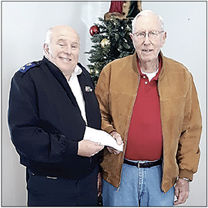 The Clock Man Donates to The Salvation Army