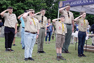 Members of Boy Scout Troop 92 in Kings Mountain salute during the National Anthem
