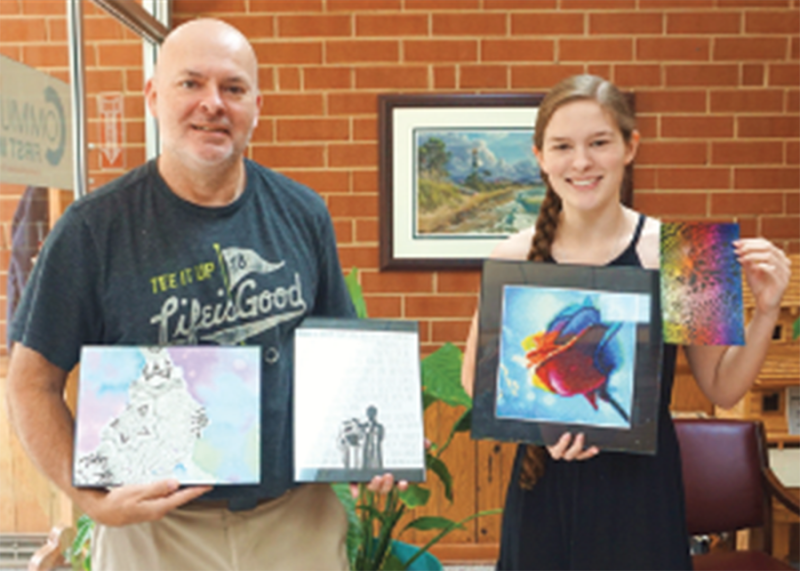 Allie MacArthur and her Dad Noel with some of her art she is wanting to sell to raise money for The Neal Center.