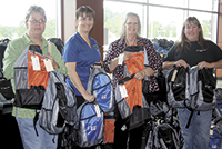 """Communities In Schools """"Backpack Program"""" Receives A Helping Hand From Local Companies"""
