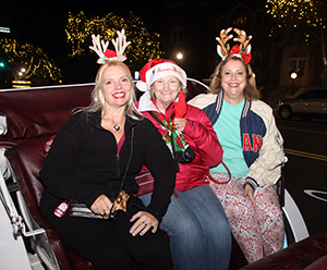 Carol Hartis, Barb McConnor and Marcella Bowan get ready for their horse and carriage ride in Uptown Shelby on Friday, November 27th. For information